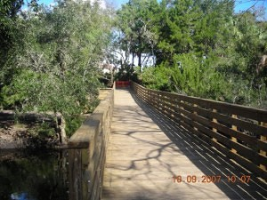 A timber pedestrian boardwalk bridge provides public access to the waterfront